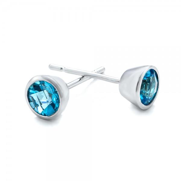 Blue Topaz Bezel Set Stud Earrings - Laying View