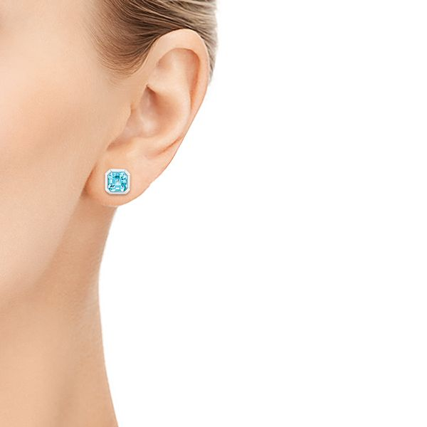 Blue Topaz Stud Earrings - Hand View -  106037