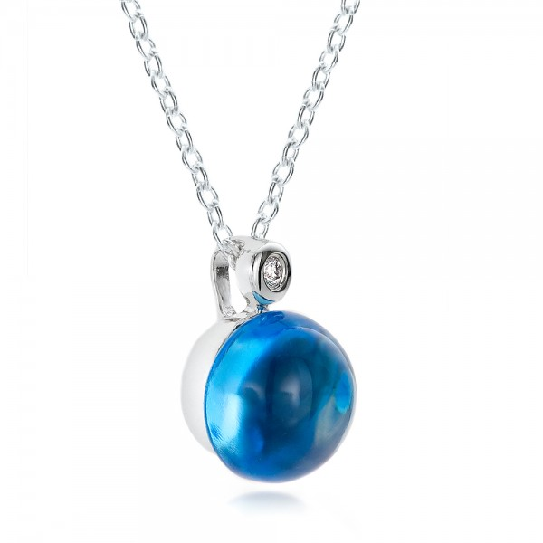Blue Topaz Cabochon and Diamond Pendant - Laying View