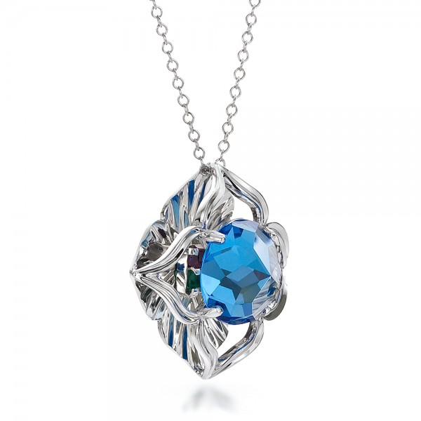 Blue Topaz and White Gold Pendant