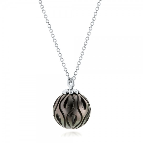 Carved Tahitian Pearl Pendant - Laying View