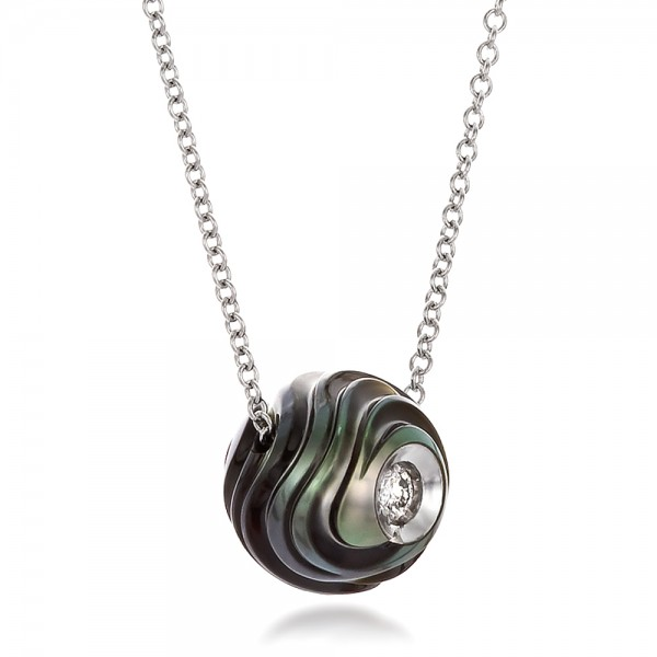 Carved Tahitian Pearl and Diamond Pendant - Laying View
