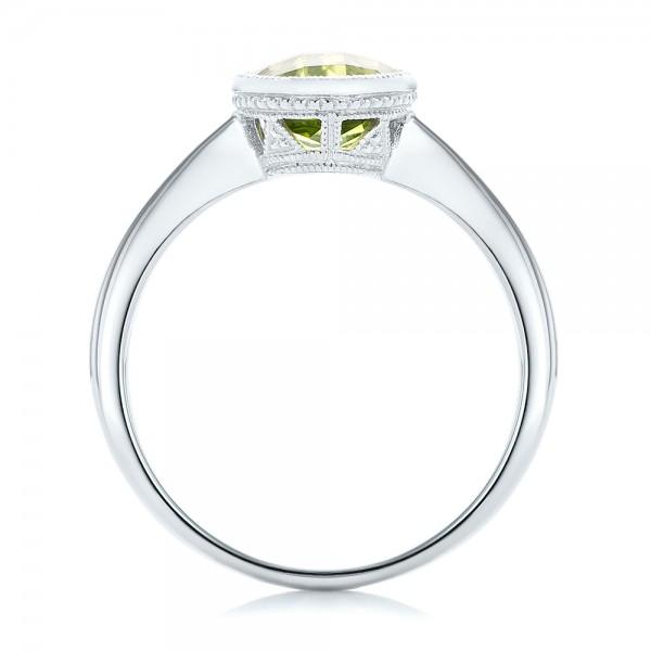 Bezel Set Peridot Ring - Finger Through View