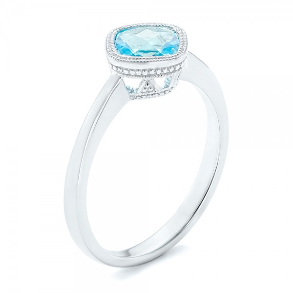 Solitaire Blue Topaz Ring