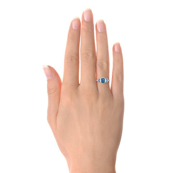 14k White Gold Emerald Cut Blue Topaz And Diamond Three-stone Ring - Hand View -  106024 - Thumbnail
