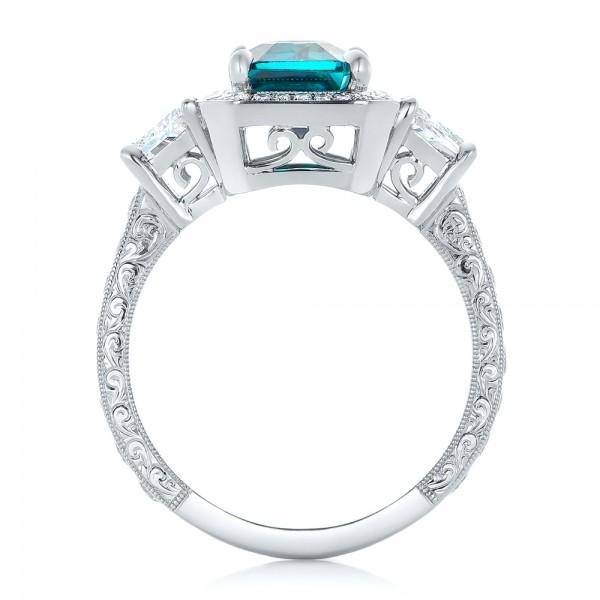 Custom Blue Zircon and Diamond Halo Engagement Ring - Finger Through View