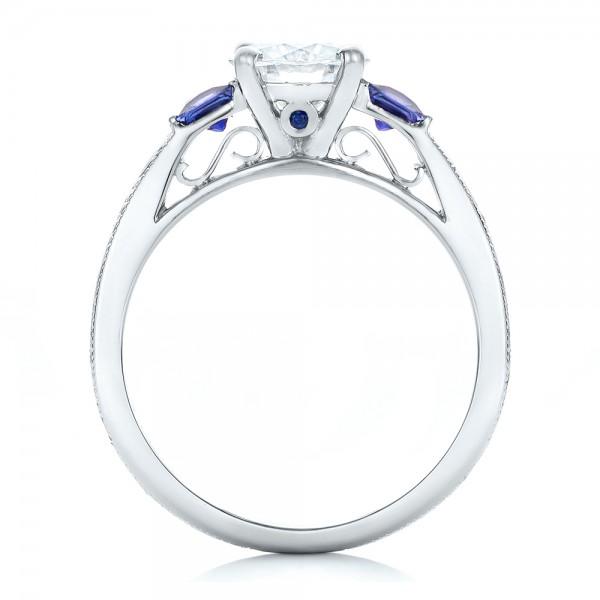 Custom Moissanite and Blue Sapphire Engagement Ring - Finger Through View