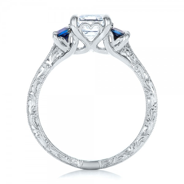 Custom Engraved Blue Sapphire and Diamond Engagement Ring - Finger Through View