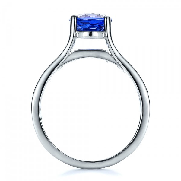 Custom Oval Blue Sapphire Engagement Ring - Finger Through View