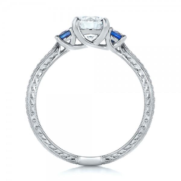 Custom Three-Stone Diamond and Blue Sapphire Engagement Ring - Finger Through View