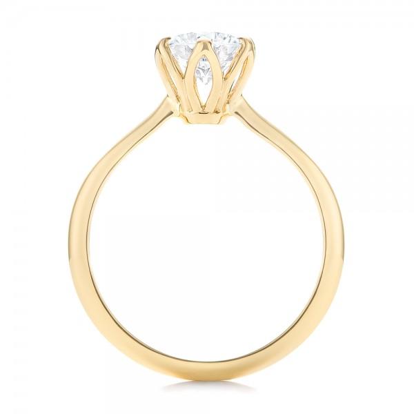 Elegant Solitaire Engagement Ring - Finger Through View