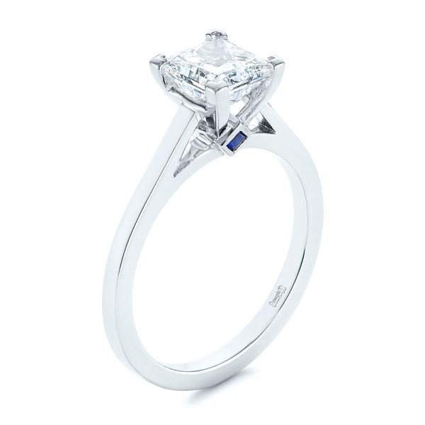 Platinum Peekaboo Blue Sapphire And Diamond Solitaire Engagement Ring - Three-Quarter View -