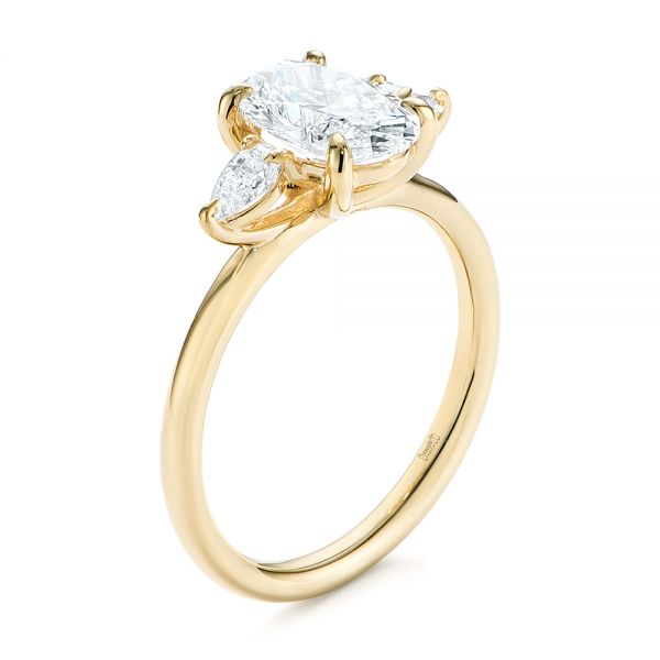 14k Yellow Gold Three Stone Oval And Pear Diamond Engagement Ring - Three-Quarter View -