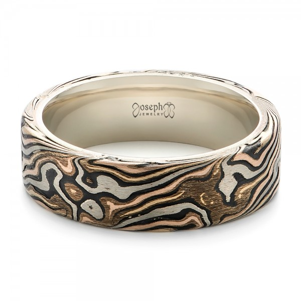 custom mens white gold and mokume wedding band laying view