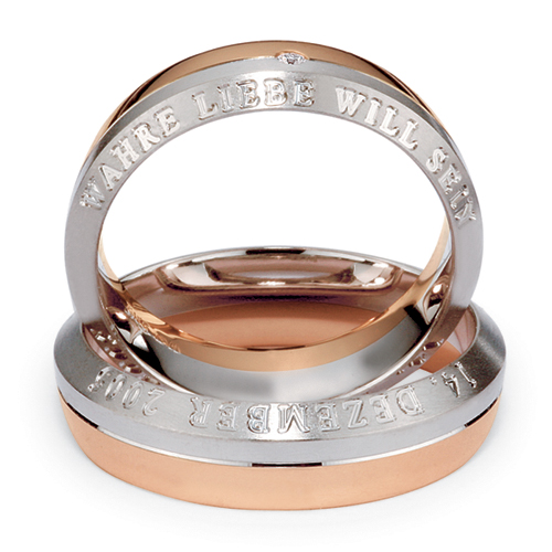 mens inscribed platinum rose gold and diamond band laying view