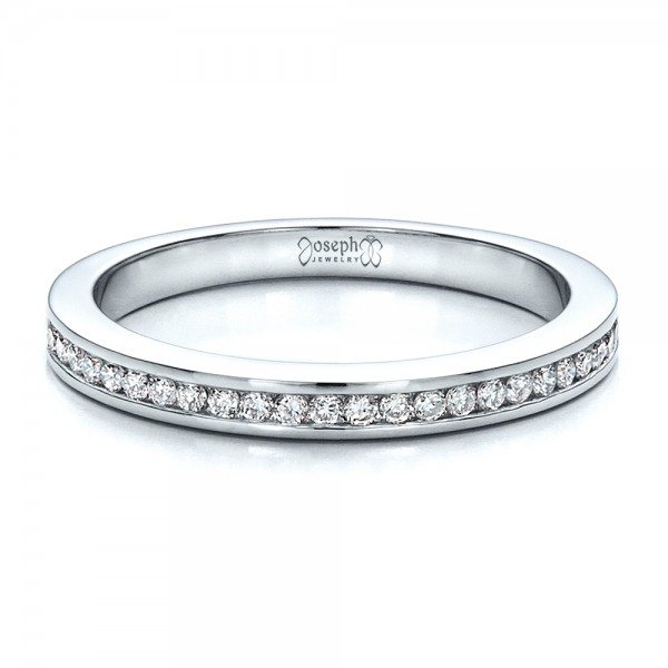 #1474 This elegant women's wedding ring features a row of round diamonds channel set across the top of the white gold band. It's made to match this engagement r