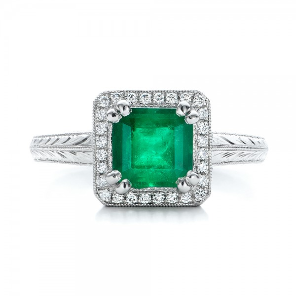 custom emerald and halo engagement ring